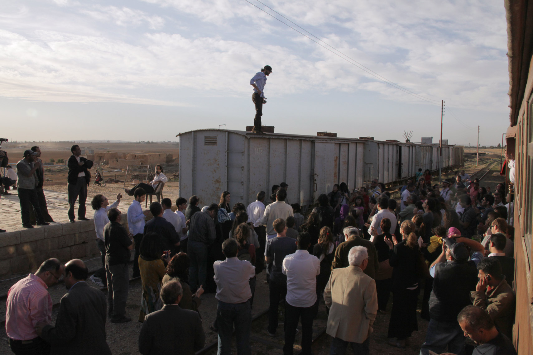 Syrian poet Ayham Agha performs on top of trains in Giza.
